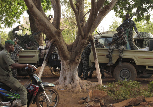 Soldiers stand guard at junta headquarters in Kati, outskirt Bamako, Mali Tuesday, April 3, 2012. With coup leader Capt. Amadou Haya Sanogo refusing to step down, surrounding nations have imposed severe financial sanctions on Mali, including the closing of the country&#39;s borders and the freezing of its account at the regional central bank. (AP Photo/Rukmini Callimachi)