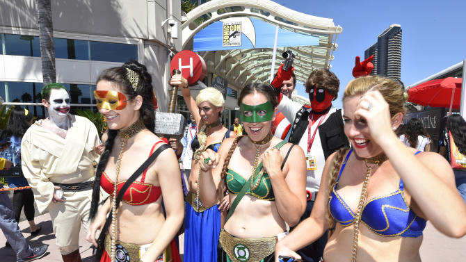 Costumed characters walk outside of the convention center on day 1 of the 2014 Comic-Con International Convention held Thursday, July 24, 2014 in San Diego. (Photo by Denis Poroy/Invision/AP)