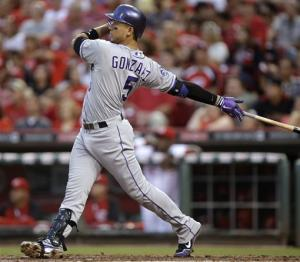Gonzalez hits 3 HRs, Rockies pound Reds 12-4