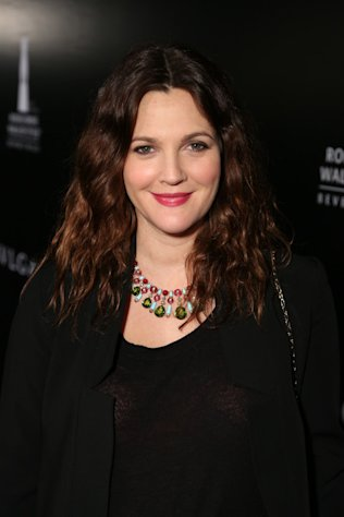 Drew Barrymore shows off her Bulgari necklace at the Rodeo Drive Walk of Style Awards on December 5, 2102.
