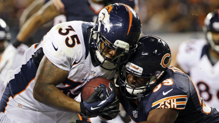 Denver Broncos running back Lance Ball (35) scores a touchdown past Chicago Bears linebacker Patrick Trahan (59) during the first half of an NFL preseason football game in Chicago, Thursday, Aug. 9, 2012. (AP Photo/Nam Y. Huh)