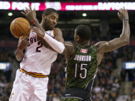 Australian-born Kyrie Irving has hit a three-pointer to give Cleveland a 99-98 NBA win over Toronto