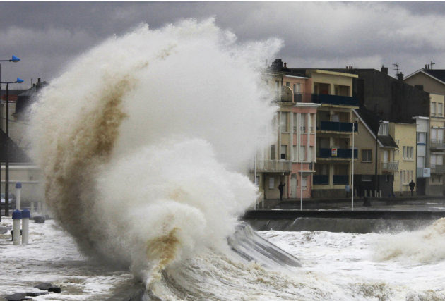 Waves hit the sea wall in…