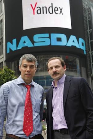 FILE - Ilya Segalovich, left, CTO of Yandex, and CEO Arkady Volozh, pose for photos in front of the Nasdaq Market Site following the company's IPO, in this May 24, 2011 file photo taken in New York. Russia's largest search engine, Yandex, said Sunday July 28, 2013 its co-founder Ilya Segalovich died Saturday. He was 48. (AP Photo/Mark Lennihan, File)