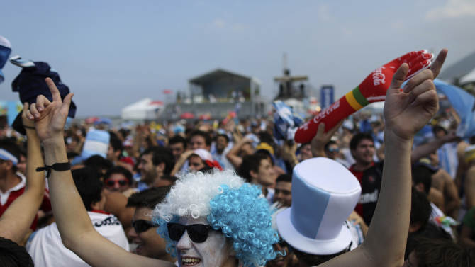 Argentine soccer fans get revved up before the live telecast of the World Cup round of 16 match between Argentina and Switzerland, at the FIFA Fan Fest area on Copacabana beach in Rio de Janeiro, Brazil, Tuesday, July 1, 2014. (AP Photo/Leo Correa)