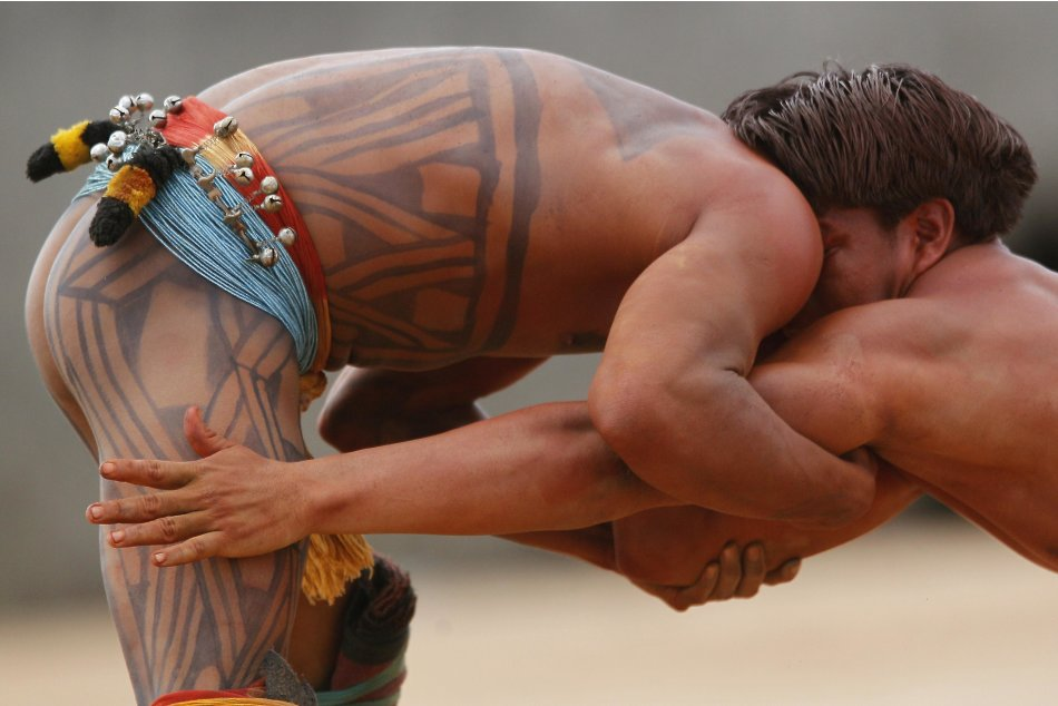 Yawalapiti men wrestle in the Xingu National Park