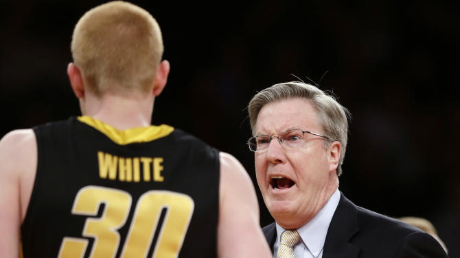 Iowa coach Fran McCaffery talks to Aaron White (30) during the first half of the NIT championship basketball game against Baylor, Thursday, April 4, 2013, in New York. (AP Photo/Frank Franklin II)