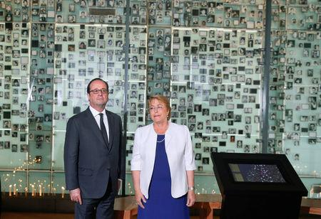 Chile's President Michelle Bachelet  and her French counterpart Francois Hollande attend a visit to the Museum of Memory and Human Rights in Santiago,  during Hollande's official visit to the country.