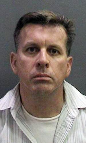 This image provided by the Orange County District Attorney's Office shows a booking photo of Rainer Reinscheid, 48, a professor at the University of California, Irvine, who was arrested July 24, 2012 and charged with numerous felony arson charges. Bail has been denied for a college professor charged with arson for allegedly setting a series of fires at an Orange County high school his son once attended before committing suicide. District attorney's spokeswoman Farrah Emami says a judge ordered Reinscheid held without bail at a hearing Tuesday, and postponed his arraignment until Aug. 8. (AP Photo/Orange County District Attorney's Office)