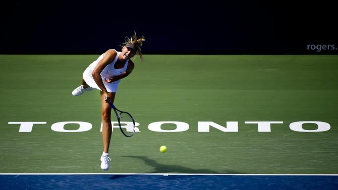 Maria Sharapova, of Russia, serves to Galina Voskoboeva, of Kazakhstan, during the Rogers Cup women's tennis tournament in Toronto on Thursday, Aug. 11, 2011. (AP Photo/The Canadian Press, Nathan Denette)
