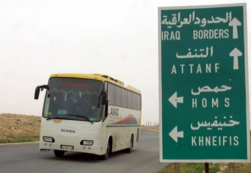 A bus crosses the Syria-Iraq border on its way to Damascus in 2003