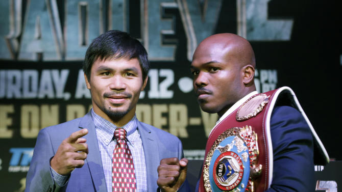 FILE - In this Feb. 6, 2014 file photo, boxer Manny Pacquiao, of the Phillipines, left, poses for a photo with current WBO World Welterweight champion Timothy Bradley of Indio, Ca., during a press conference in New York. Bradley believes former pound-for-pound king Pacquiao has lost his competitive fire heading into Saturday's, April 12, 2014 welterweight rematch in Las Vegas. (AP Photo/Kathy Willens)