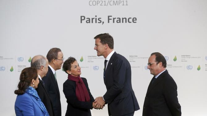 Netherlands Prime Minister Rutte is welcomed by French President Hollande as he arrives for the opening day of the World Climate Change Conference 2015 (COP21) at Le Bourget, near Paris