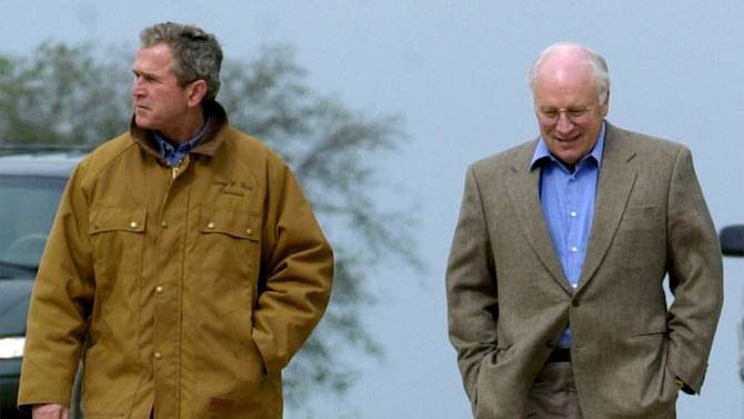 """FILE- This Nov. 11, 2000 file photo shows then Republican presidential candidate Texas Gov. George W. Bush and running mate Dick Cheney walk down a dirt road to meet with reporters, followed by Bush's dog Spot, near Crawford, Texas. For the new book """"Pets at the White House,"""" Dallas author Jennifer Boswell Pickens interviewed everyone from first family members to White House staffers to give readers a glimpse at what life is like at 1600 Pennsylvania Ave. for pets and what those pets have meant to their famous owners. (AP Photo/Eric Draper, file)"""