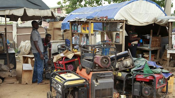 A man is seen working on power generators at the Area 10 shopping centre in Abuja, Nigeria