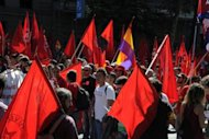 <p>People take part in a demonstration in Madrid on September 15. Mass protests in Spain and Portugal, against ever tougher austerity measures, have ramped up the pressure on Iberian governments struggling to avoid international bailouts.</p>