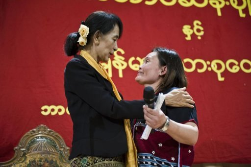 &lt;p&gt;Myanmar democracy icon Aung San Suu Kyi (L) speaks to Naw Star Ri (R) during a meeting with Myanmar refugees in Norway at the Rafto Foundation, a human rights organization, in Bergen on June 17, 2012. Suu Kyi will meet on Monday one of her biggest fans at a Norwegian peace forum -- Bono, the U2 frontman and activist rock star who has written a song about her.&lt;/p&gt;