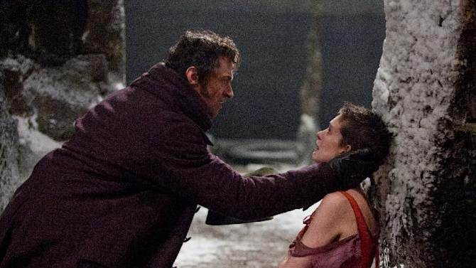 """This film image released by Universal Pictures shows Hugh Jackman as Jean Valjean, left, and Anne Hathaway as Fantine in a scene from """"Les Miserables.""""  The film was nominated for a Golden Globe for best musical or comedy on Thursday, Dec. 13, 2012. The 70th annual Golden Globe Awards will be held on Jan. 13. (AP Photo/Universal Pictures)"""