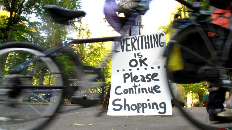 A joke sign is seen at one of several entrances to the Occupy Portland camp in Portland, Ore.,  Tuesday, Oct. 18, 2011. Occupy protesters want shoppers to occupy something besides door-buster sales and crowded aisles of big-box stores on Black Friday. (AP Photo/Don Ryan)