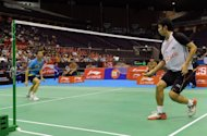 Boonsak Ponsana (R) of Thailand eyes the shuttle cock as he plays against Nguyen Tien Minh of Vietnam in the men&#39;s single semi-final of the Singapore Open Super series badminton in Singapore. Boonsak won 21-12 18-21 21-19