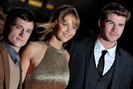 L-R: Josh Hutcherson, Jennifer Lawrence and Liam Hemsworth attend the European Premiere of &#39;The Hunger Games&#39; in east London on March 14. Teen movie phenomenon &quot;The Hunger Games&quot; is vying to set a US box office record this weekend, after advance sales already put it in the top three, according to a major ticket seller Thursday
