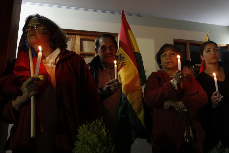 People participate in a vigil for Venezuela's President Hugo Chavez in La Paz, Bolivia, Monday Dec. 10, 2012. Chavez's cancer relapse and his sudden announcement that he will undergo a fourth cancer-related surgery in Cuba have thrown Venezuela's future into question. (AP Photo/Juan Karita)