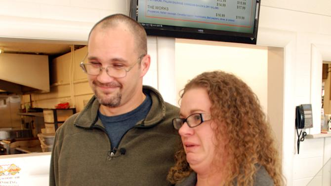 Misti Gunn fights back tears Tuesday, Jan. 15, 2013, at a market in Merlin, Ore., as she describes the financial hardship her family went through before winning $1 million in the Oregon Lottery. Rily Gunn said he was driving his family home to their cabin in the woods after registering for computer programming classes when he pulled off the freeway for corn dogs for the kids, and decided on a hunch to buy a lottery ticket, though he knew his wife would disapprove. (AP Photo/Jeff Barnard)