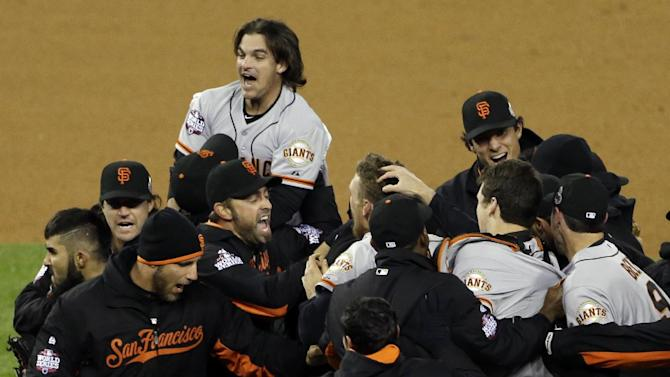 The San Francisco Giants celebrate after winning Game 4 of baseball's World Series against the Detroit Tigers Sunday, Oct. 28, 2012, in Detroit. The Giants won 4-3 to win the series. (AP Photo/Paul Sancya )