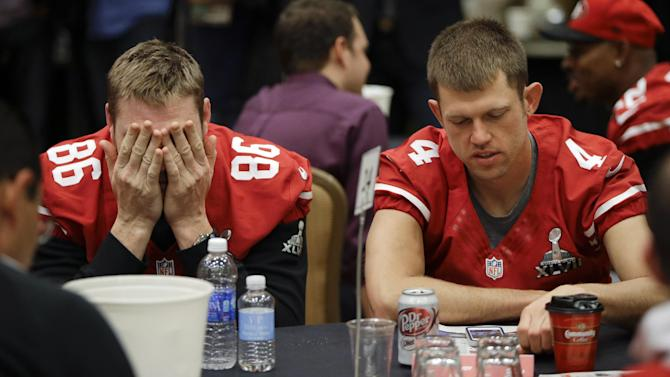 San Francisco 49ers long snapper Brian Jennings (86) and punter Andy Lee (4) wait to be interviewed during a media availability on Wednesday, Jan. 30, 2013, in New Orleans. The 49ers are scheduled to play the Baltimore Ravens in the NFL Super Bowl XLVII football game on Feb. 3. (AP Photo/Mark Humphrey)