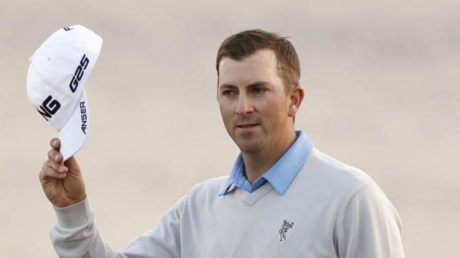 Michael Thompson acknowledges the crowd as he arrives at the 18th hole before winning the final round of the Honda Classic golf tournament on Sunday, March 3, 2013, in Palm Beach Gardens, Fla. (AP Photo/Wilfredo Lee)