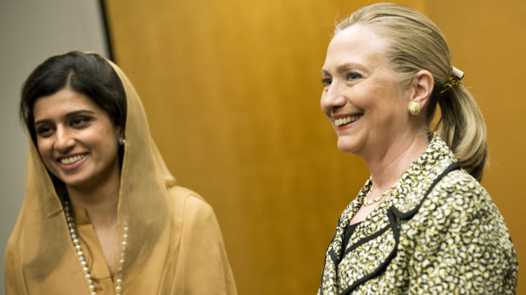 U.S. Secretary of State Hillary Rodham Clinton, right, and Pakistan Foreign Minister Hina Rabbani Khar poses before a bilateral meeting at a hotel in Tokyo Sunday, July 8, 2012. (AP Photo/Brendan Smialowski, Pool)