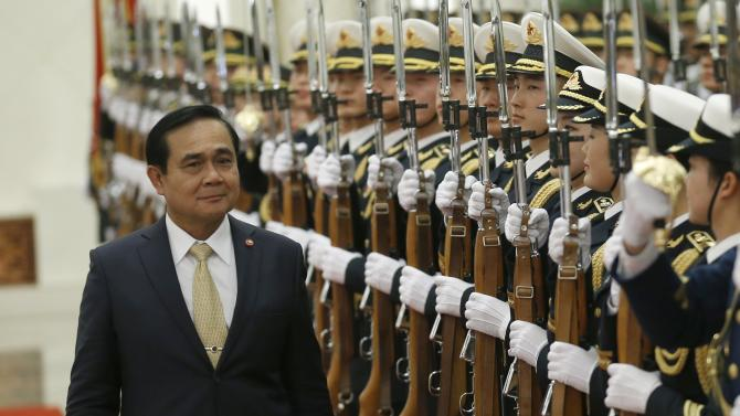 Thailand's Prime Minister Prayuth Chan-ocha inspects honour guards during a welcoming ceremony inside the Great Hall of the People in Beijing