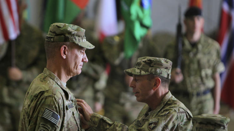 General David Petraeus right, Commanding General, ISAF and U.S forces in Afghanistan pins on medal to the outgoing Lt.Gen. David M. Rodriguez Commander, ISAF Joint Command and Deputy Commander U.S forces in Afghanistan during a change of command ceremony in Kabul, Afghanistan, Monday, July 11, 2011.Rodriguez says violence is down in some heavily populated areas of Afghanistan where coalition troops have been heavily concentrated, but that violence continues in rural areas outside the cities(AP Photo/Rafiq Maqbool)