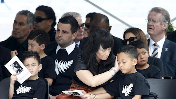 Former All Black Jonah Lomu's widow Nadene Lomu sits with her two sons, Brayley Lomu and Dhyreille (R) Lomu in Eden Park for Jonah's memorial service in Auckland