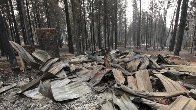 The burned remains of a home destroyed by a Ponderosa fire are seen near Manton, Calif., Monday, Aug. 20, 2012. More than 1,400 fire fighters are battling the fire that has destroyed seven homes, burned 23 square miles. The fire that started Saturday is just 5 percent contained. (AP Photo/Rich Pedroncelli)