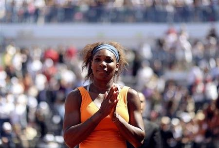 Williams of the U.S. waits at the medal ceremony after winning the women's singles final match at the Rome Masters tennis tournament