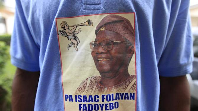 """A shirt bearing the image of the late Isaac Fadoyebo is seen on a man at the ceremony honoring the late World War II combatant in Lagos, Nigeria, on Thursday, Jan. 24, 2013. Fadoyebo, who died in November at the age of 86, represents one of the last so-called """"Burma Boys"""" still living through West and East Africa. On Thursday, his family and friends gathered for a final worship service and celebration of his life, as new attention has been paid to his sacrifices and those of other Africans drawn into the fighting. (AP Photo/Jon Gambrell)"""