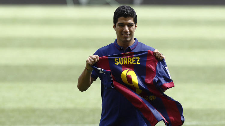 Barcelona's new Uruguayan forward Luis Suarez poses during his official presentation at the Camp Nou stadium in Barcelona on August 19, 2014