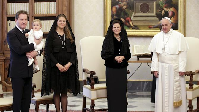 Pope Francis poses with Sweden's Queen Silvia, Princess Madeleine and her husband O'Neill  holding their daughter Princess Leonore during a meeting at the Vatican
