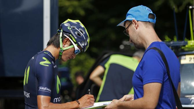 Movistar rider Gorka Izagirre of Spain signs autographs in front of his hotel before a team training session in Utrecht, Netherlands