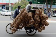File photo shows a man riding a tricycle loaded with handcrafted baskets in Phnom Penh. The World Bank on Monday slashed its 2012 growth forecast for developing countries in East Asia and the Pacific to 7.2%, down from a May forecast of 7.6% growth in the region this year