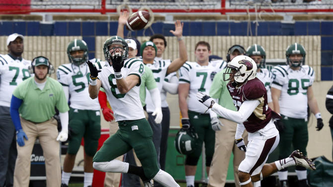 Ohio wide receiver Chase Cochran (8) catches a 68-yard touchdown pass in front of Louisiana-Monroe safety Mitch Lane (38) during the first quarter of the Independence Bowl NCAA college football game in Shreveport, La., Friday, Dec. 28, 2012. (AP Photo/Rogelio V. Solis)
