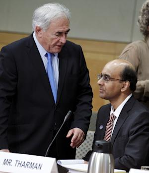 International Monetary Fund (IMF) Managing Director Dominique Strauss-Kahn, left, speaks with International Monetary and Financial Committee Chairman Tharman Shanmugaratnam, the Minister of Finance of Singapore, as they attend the International Monetary and Financial Committee during the IMF/World Bank spring meetings in Washington on Saturday, April 16, 2011. (AP Photo/Jose Luis Magana)