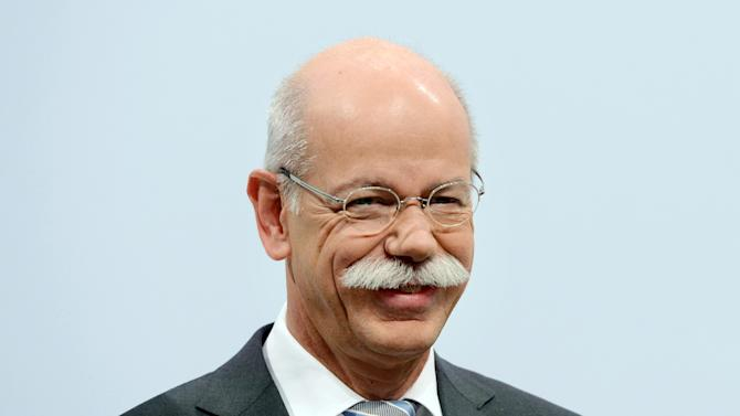 Dieter Zetsche, CEO of the motor company Daimler AG, attends the balance press conference of the company in Stuttgart, Germany, Thursday, Feb. 7, 2013. Daimler said Thursday that fourth quarter net profit was euro 2.3 billion (US dollar 3.1 billion), up from euro 1.79 billion in the same quarter last year, thanks to the sale of 7.5 percent in European defense company EADS. (AP Photo/dpa, Franziska Kraufmann)