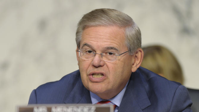 FILE - In this Sept. 4, 2013, file photo, Sen. Robert Menendez, D-N.J. speaks at Capitol Hill in Washington. Key Democratic and Republican senators are crafting legislation to reinstate the full force of Iran sanctions and impose new ones if Tehran doesn't make good on its pledge to roll back its nuclear program, brushing aside the Obama administration's fears about upending its diplomatic momentum. Menendez and Sen. Mark Kirk, R-Ill., hope to have the bill ready for other lawmakers to consider when the Senate returns Dec. 9 from its two-week recess, according to legislative aides. (AP Photo/Susan Walsh)