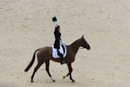 Japan's Yoshiaki Oiwa on Noonday De Conde acknowledges the audience after riding in the Dressage phase of the Eventing competition at the Equestrian venue in Greenwich Park, London, during the London 2012 Olympics