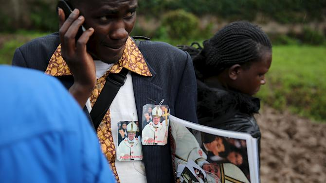 A street vendor sells souvenirs before a mass by Pope Francis in Kenya's capital Nairobi,