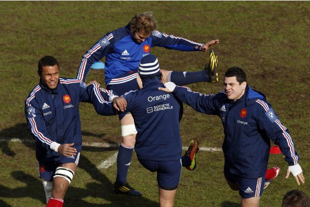 France's rugby players Thierry Dusautoir, Antonie Claassen and Guilhem Guirado attend a training session at the Rugby Union National Centre in Marcoussis