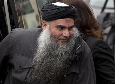 File photograph shows Radical Muslim cleric Abu Qatada, arriving back at his home after being released on bail, in London
