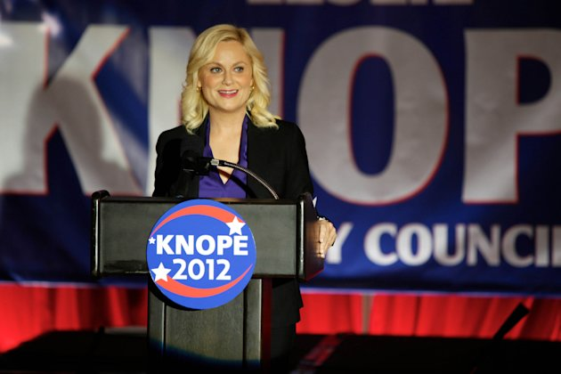 "This image released by NBC shows Amy Poehler as Leslie Knope in a scene from ""Parks and Recreation."" Knope, a dedicated public servant in fictional Pawnee, Ind., used to be Deputy Parks Director, but at the end of last season, she won a seat on the Pawnee City Council. The high drama of this political season has been echoed by episodic TV like CBS' ""The Good Wife,"" and Showtime's ""Homeland"" where character Nicholas Brody returns home after eight years' imprisonment in Afghanistan and becomes a U.S. Congressman. (AP Photo/NBC, Tyler Golden)"